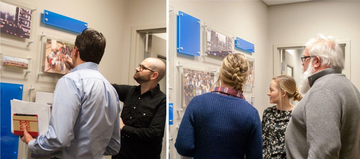 CSI employees looking at new photo display
